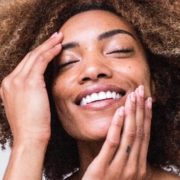 Smiling smooth skin after aesthetic treatment